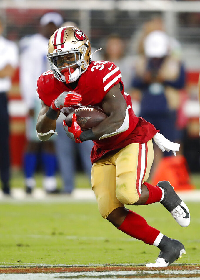 San Francisco 49ers' Austin Walter carries against the Dallas Cowboys during the second half of an NFL preseason football game in Santa Clara, Calif., Saturday, Aug. 10, 2019. (AP Photo/John Hefti)