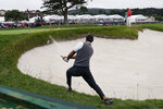 Tiger Woods hits out of the bunker on the 18th hole during the first round of the U.S. Open Championship golf tournament Thursday, June 13, 2019, in Pebble Beach, Calif. (AP Photo/Carolyn Kaster)