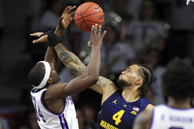 Howard, Cain help Marquette hold off Kansas St., win 73-65