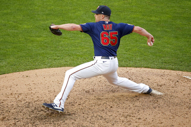 FILE - In this Sept. 4, 2020, file photo, Minnesota Twins relief pitcher Trevor May throws to a Detroit Tigers batter during the second game of a baseball doubleheader in Minneapolis. The New York Mets reached their first agreement with a free agent since Steven Cohen bought the team, a deal with 31-year-old May, a person familiar with the negotiations tells The Associated Press. The person spoke on condition of anonymity Tuesday, Dec. 1,  because the agreement is subject to a successful physical. (AP Photo/Bruce Kluckhohn, File)