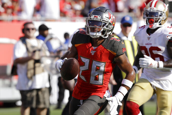 Tampa Bay Buccaneers cornerback Vernon Hargreaves III (28) runs the ball into the end zone for a touchtown after his interception against the Tampa Bay Buccaneers during the first half an NFL football game, Sunday, Sept. 8, 2019, in Tampa, Fla. (AP Photo/Chris O'Meara)