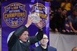 LSU head coach Ed Orgeron holds up the American Football Coaches Association National Championship Trophy during a celebration of their NCAA college football championship, Saturday, Jan. 18, 2020, on the LSU campus in Baton Rouge, La. (AP Photo/Gerald Herbert)