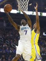 Charlotte Hornets guard Dwayne Bacon (7) shoots against Golden State Warriors forward Glenn Robinson III during the first half of an NBA basketball game in San Francisco, Saturday, Nov. 2, 2019. (AP Photo/Jeff Chiu)