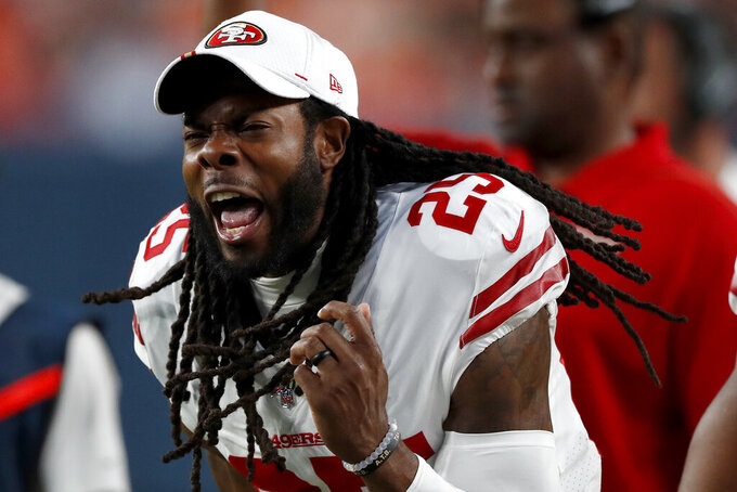 San Francisco 49ers cornerback Richard Sherman (25) celebates a touchdown from the sidelines during the second half of an NFL preseason football game against the Denver Broncos, Monday, Aug. 19, 2019, in Denver. (AP Photo/David Zalubowski)