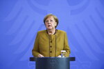 German Chancellor Angela Merkel speaks at a press conference in Berlin, Germany, Tuesday, April 13, 2021. The Chancellor spoke about the current situation in the Corona pandemic and the amendments to the Infection Protection Act that the Federal Government passed on Tuesday. (Annegret Hilse/AP via Pool)
