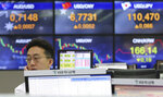 A currency trader watches monitors at the foreign exchange dealing room of the KEB Hana Bank headquarters in Seoul, South Korea, Monday, Feb. 18, 2019. Asian markets were broadly higher on Monday as traders looked forward to the continuation of trade talks between Chinese and American officials in Washington this week. (AP Photo/Ahn Young-joon)
