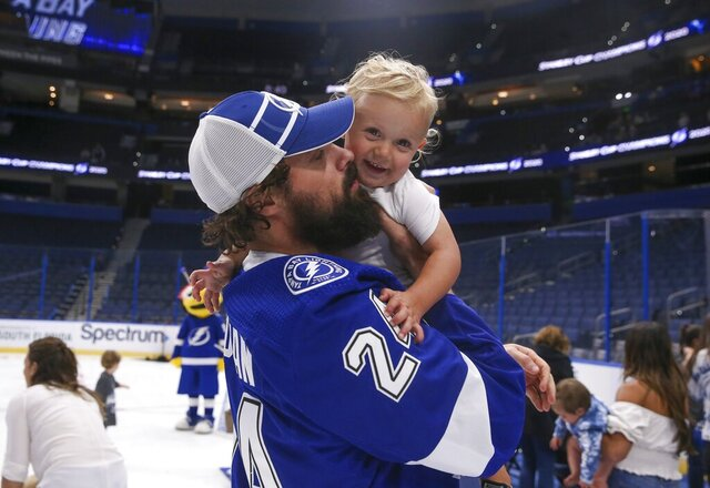 FILE  - In this Tuesday, Sept. 29, 2020, file photo, Tampa Bay Lightning's Zach Bogosian holds his son Hunter during an event at Amalie Arena in Tampa, Fla. The Lightning defeated the Dallas Stars the day before to win the NHL hockey Stanley Cup. Toronto signed former Lightning defenseman Zach Bogosian. (Dirk Shadd/Tampa Bay Times via AP, File)
