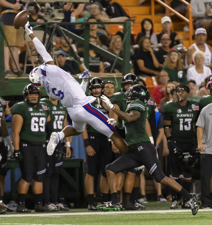Louisiana Tech wide receiver Adrian Hardy (6) can't make the catch as Hawaii defensive back Rojesterman Farris II, right, defends on the play in the first half of the Hawaii Bowl NCAA college football game, Saturday, Dec. 22, 2018, in Honolulu. (AP Photo/Eugene Tanner)