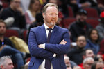 Milwaukee Bucks head coach Mike Budenholzer watches his team during the second half of an NBA preseason basketball game against the Chicago Bulls, Monday, Oct. 7, 2019, in Chicago. (AP Photo/Charles Rex Arbogast)