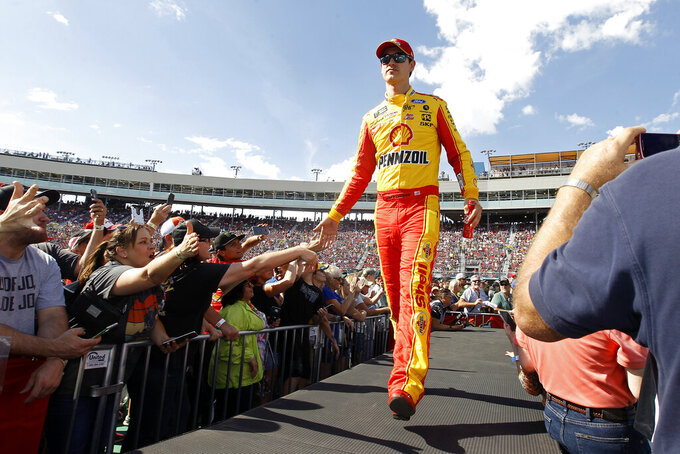 Joey Logano greets fans during driver introductions prior to the NASCAR Cup Series auto race at ISM Raceway, Sunday, Nov. 10, 2019, in Avondale, Ariz. (AP Photo/Ralph Freso)