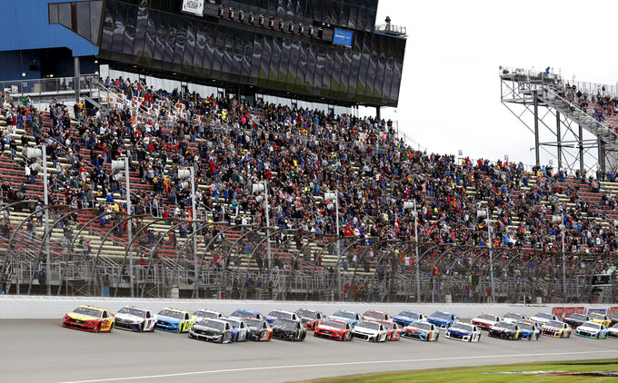 Drivers start a NASCAR Cup Series auto race at Michigan International Speedway, Monday, June 10, 2019, in Brooklyn, Mich. (AP Photo/Carlos Osorio)