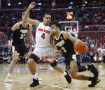 Purdue's Carsen Edwards, right, drives to the basket against Ohio State's Duane Washington during the first half of an NCAA college basketball game Wednesday, Jan. 23, 2019, in Columbus, Ohio. (AP Photo/Jay LaPrete)