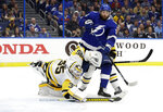 Pittsburgh Penguins goaltender Tristan Jarry (35) makes a diving stop on a shot by the Tampa Bay Lightning during the second period of an NHL hockey game Wednesday, Oct. 23, 2019, in Tampa, Fla. Looking for a rebound is Lightning's Pat Maroon (14). (AP Photo/Chris O'Meara)