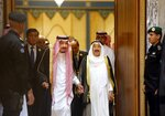 FILE - In this Saturday, June 1, 2019 file photo, Saudi King Salman, center left, is accompanied by Kuwait's Emir Sheikh Sabah al-Ahmad al-Jaber al-Sabah, center right, as they enter the Islamic Summit of the Organization of Islamic Cooperation (OIC) in Mecca, Saudi Arabia. Kuwait state television said Tuesday, Sept. 29, 2020, the country's 91-year-old ruler, Sheikh Sabah Al Ahmad Al Sabah, had died. (AP Photo/Amr Nabil, File)