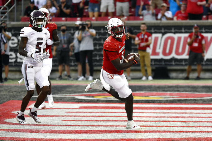 Louisville quarterback Malik Cunningham (3) runs for a touchdown during the first half of an NCAA college football game against Eastern Kentucky in Louisville, Ky., Saturday, Sept. 11, 2021. (AP Photo/Timothy D. Easley)