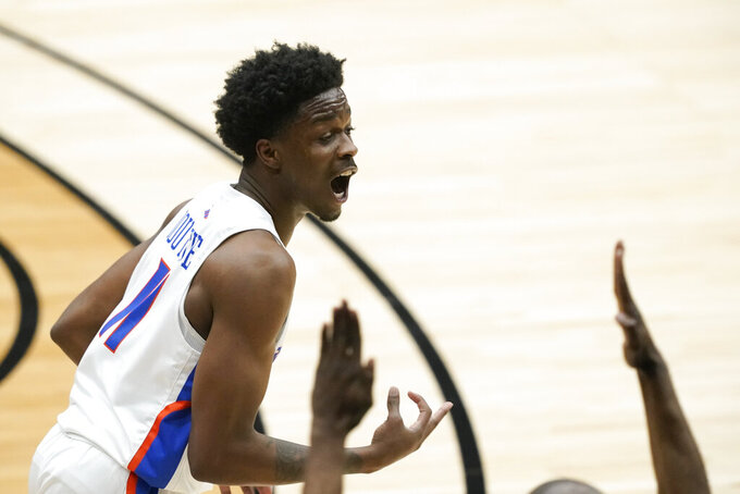 Boise State guard Devonaire Doutrive celebrates after making a 3-point basket during the first half of an NCAA college basketball game against SMU in the first round of the NIT, Thursday, March 18, 2021, in Frisco, Texas. (AP Photo/Tony Gutierrez)