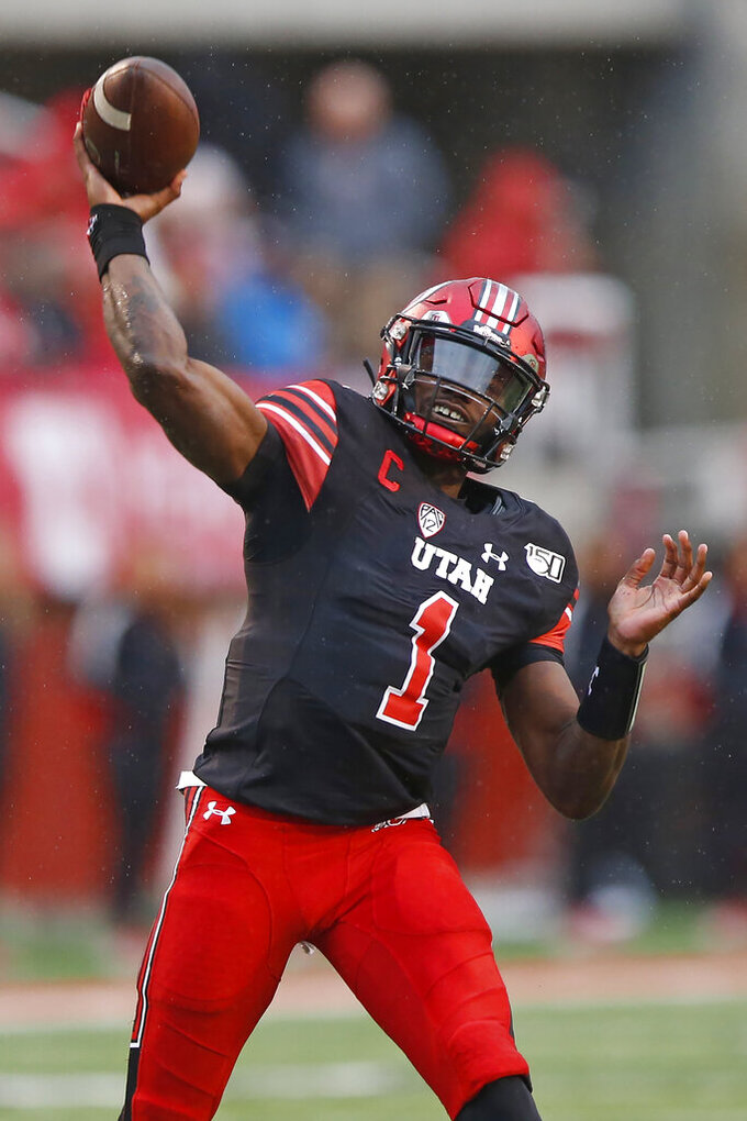 Utah quarterback Tyler Huntley throws a pass during the first half of an NCAA college football game against Arizona State on Saturday, Oct. 19, 2019, in Salt Lake City. (AP Photo/Rick Bowmer)