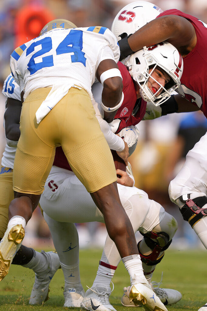 Stanford quarterback Tanner McKee (18) is sacked by UCLA defensive back Qwuantrezz Knight (24) during the first half of an NCAA college football game Saturday, Sept. 25, 2021, in Stanford, Calif. (AP Photo/Tony Avelar)