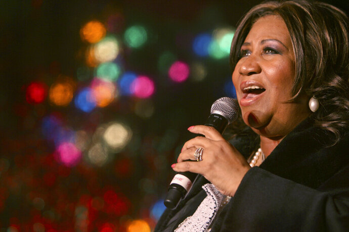FILE - In this Dec. 4, 2008 file photo, Aretha Franklin performs during the 85th annual Christmas tree lighting at the New York Stock Exchange in New York. Three handwritten wills have been found in the suburban Detroit home of Franklin, months after the death of the