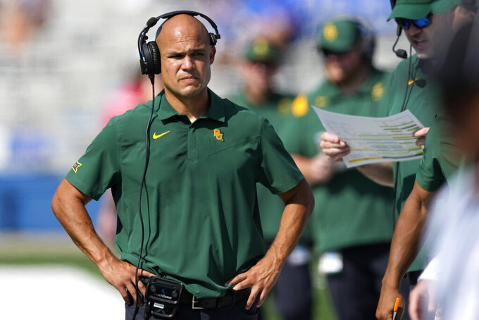 Baylor head coach Dave Aranda walks the sidelines during the first half of an NCAA college football game against Kansas in Lawrence, Kan., Saturday, Sept. 18 2021. (AP Photo/Orlin Wagner)