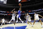 Creighton's Ty-Shon Alexander (5) goes up for a shot against Villanova's Jermaine Samuels (23) during the second half of an NCAA college basketball game, Saturday, Feb. 1, 2020, in Philadelphia. (AP Photo/Matt Slocum)