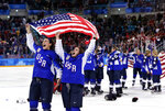 FILE - In this Feb. 22, 2018, file photo,  United States players celebrate after winning the women's gold medal hockey game against Canada at the 2018 Winter Olympics in Gangneung, South Korea. (AP Photo/Frank Franklin II, File)