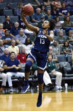 Connecticut's Christyn Williams leaps for a layup during the second half of an NCAA basketball game against South Florida, Monday, March 4, 2019, in Tampa, Fla. (AP Photo/Steve Nesius)