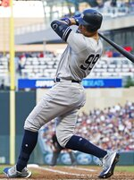 New York Yankees' Aaron Judge rears back from a close pitch by Minnesota Twins pitcher Jake Odorizzi in the second inning of a baseball game Wednesday, July 24, 2019, in Minneapolis. (AP Photo/Jim Mone)