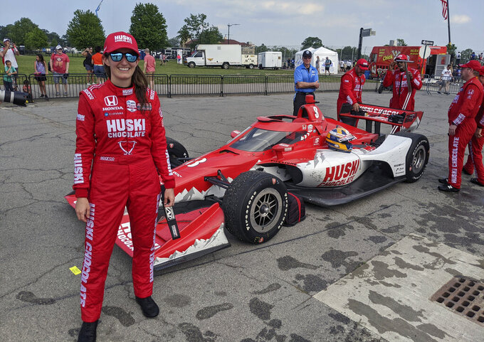 In this photo provided by Chip Ganassi Racing, engineer Angela Ashmore poses after Marcus Ericsson, of Sweden, won the first race of the IndyCar Detroit Grand Prix auto racing doubleheader on Belle Isle in Detroit, Saturday, June 12, 2021. The last three IndyCar races have been won by drivers who have female engineers on their teams, a trend that could continue Sunday at Mid-Ohio Sports Car Course. (Chip Ganassi Racing via AP)
