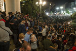 Protesters gather in front of the Serbian parliament in Belgrade, Serbia, Tuesday, July 7, 2020. Thousands of people protested the Serbian president's announcement that a lockdown will be reintroduced after the Balkan country reported its highest single-day death toll from the coronavirus Tuesday. (AP Photo/Marko Drobnjakovic)