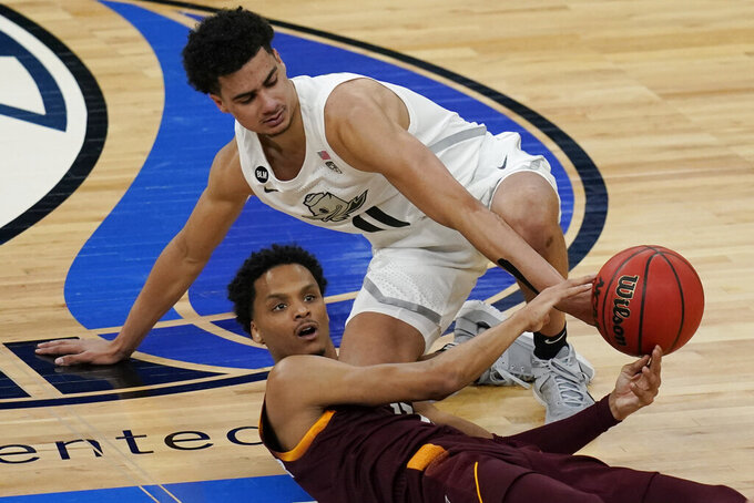 Oregon's Will Richardson, top, and Arizona State's Alonzo Verge Jr. scramble for the ball during the first half of an NCAA college basketball game in the quarterfinal round of the Pac-12 men's tournament Thursday, March 11, 2021, in Las Vegas. (AP Photo/John Locher)