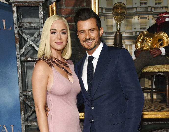 FILE - This Aug. 21, 2019 file photo shows Orlando Bloom, right, a cast member in the Amazon Prime Video series