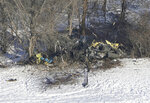 This aerial photo shows the crash site of a Minnesota National Guard Blackhawk helicopter, Friday Dec. 6, 2019, near Kimball, Minn. Three soldiers were killed in Thursday's crash at the edge of a farm field about 30 miles south of St.  Cloud. (Brian Peterson/Star Tribune via AP)