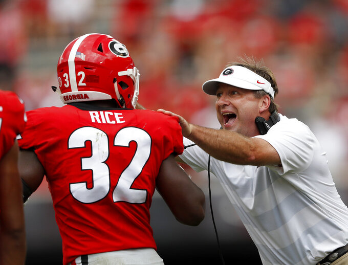 Georgia head coach Kirby Smart talks to linebacker Monty Rice (32) in the second half of an NCAA college football game against Middle Tennessee, Saturday, Sept. 15, 2018, in Athens, Ga. (AP Photo/John Bazemore)