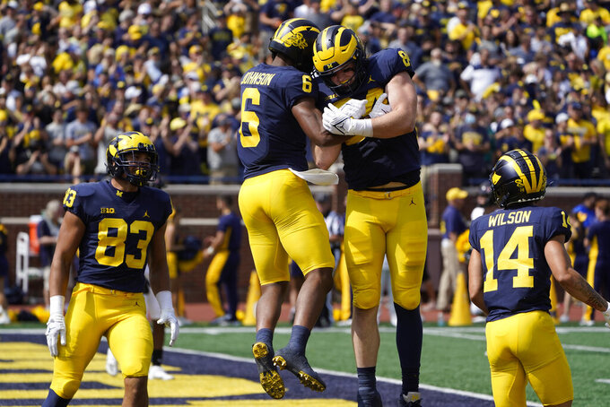 Michigan wide receiver Cornelius Johnson (6) celebrates his 87-yard touchdown reception with Joel Honigford (84) in the first half of a NCAA college football game against Northern Illinois in Ann Arbor, Mich., Saturday, Sept. 18, 2021. (AP Photo/Paul Sancya)