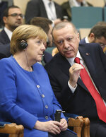 Turkey's President Recep Tayyip Erdogan, right, talks to Germany's Chancellor Angela Merkel, prior to the opening ceremony of a Turkish-German university's new campus, in Istanbul, Friday, Jan. 24, 2020. Merkel is meeting Turkish President Recep Tayyip Erdogan in Istanbul on Friday for talks that are expected to focus on the future of a migration deal between Turkey and the EU that helped decrease refugee flows to Europe. (Presidential Press Service via AP, Pool)