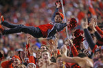 Utah fans celebrate a fumble recovery and touchdown during the first half of the team's NCAA college football game against Utah on Saturday, Nov. 16, 2019, in Salt Lake City. (AP Photo/Rick Bowmer)