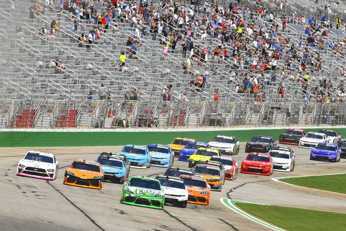 Kyle Busch leads at the start of a NASCAR Xfinity Series auto race Saturday, July 10, 2021, in Hampton, Ga. (AP Photo/John Amis)