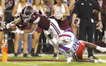 Mississippi State wide receiver Stephen Guidry (1) dives into the end zone for a touchdown as Louisiana Tech safety Jordan Baldwin (28) tries to stop him during the first half of an NCAA college football game on Saturday, Nov. 3, 2018, in Starkville, Miss. (AP Photo/Jim Lytle)