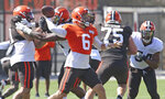 Cleveland Browns quarterback Baker Mayfield throws a pass in 11-on-11 drills during training camp, Tuesday, Aug. 18, 2020, in Berea, Ohio. (John Kuntz/The Plain Dealer via AP)
