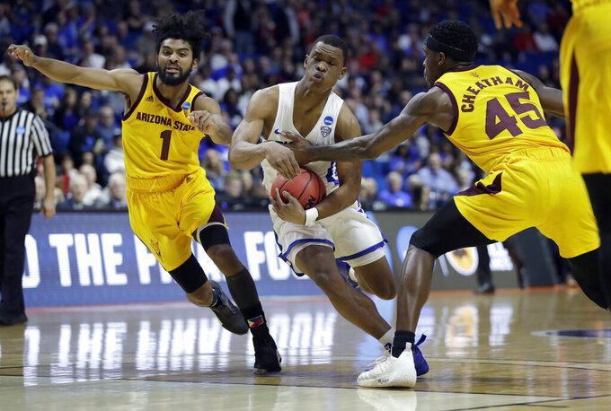 Buffalo's Davonta Jordan, center, heads to the basket between Arizona State's Remy Martin (1) an Zylan Cheatham (45) during the first half of a first round men's college basketball game in the NCAA Tournament Friday, March 22, 2019, in Tulsa, Okla. (AP Photo/Jeff Roberson)