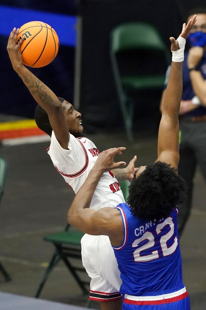 Western Kentucky guard Josh Anderson (4) goes up for a dunk attempt as Louisiana Tech forward Isaiah Crawford (22) defends during the first half of an NCAA college basketball game in the quarterfinals of the NIT, Thursday, March 25, 2021, in Frisco, Texas. (AP Photo/Tony Gutierrez)