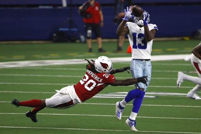 Arizona Cardinals cornerback Dre Kirkpatrick (20) defends as Dallas Cowboys wide receiver Michael Gallup (13) catches a pass in the first half of an NFL football game in Arlington, Texas, Monday, Oct. 19, 2020. (AP Photo/Ron Jenkins)