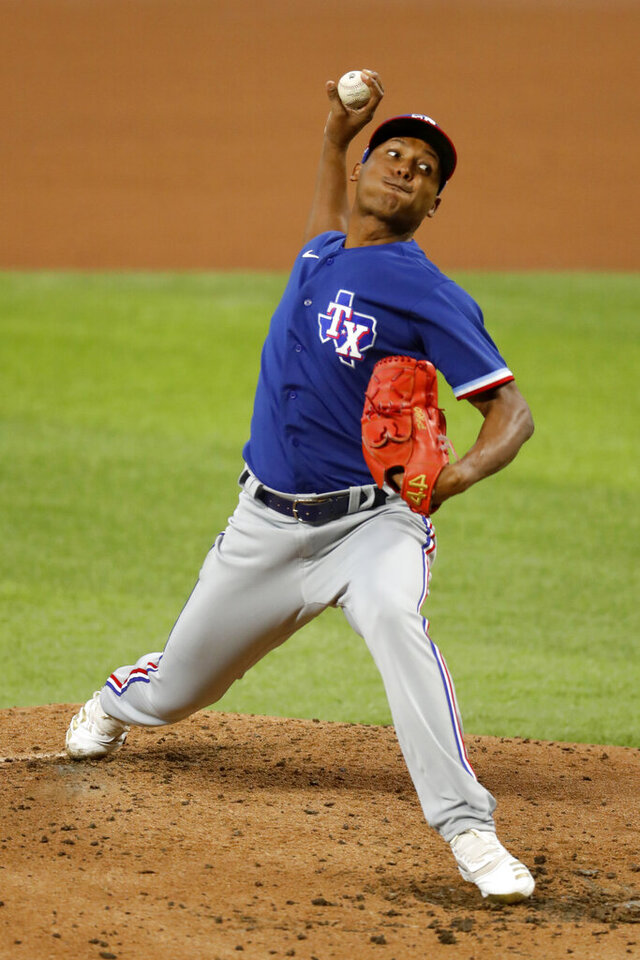 Texas Rangers pitcher Jose Leclerc throws a pitch in an intrasquad game during baseball practice at Globe Life Field in Arlington, Texas, Monday, July 20, 2020. (AP Photo/Roger Steinman)