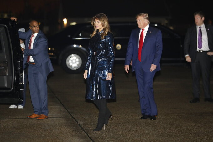 President Donald Trump and first lady Melania Trump arrive at Louis Armstrong New Orleans International airport to attend the NCAA College Football Playoff national championship game championship game between LSU and Clemson, Monday, Jan. 13, 2020, in Kenner, La. (AP Photo/ Evan Vucci)
