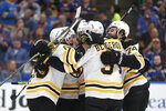 Boston Bruins center Patrice Bergeron (37) is congratulated after scoring against the St. Louis Blues during the first period of Game 3 of the NHL hockey Stanley Cup Final Saturday, June 1, 2019, in St. Louis. (AP Photo/Jeff Roberson)