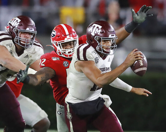 Georgia defensive lineman Tyler Clark sacks Texas A&M quarterback Kellen Mond for a 10-yard loss during the fourth quarter of an NCAA college football game Saturday, Nov. 23, 2019, in Athens, Ga. (Curtis Compton/Atlanta Journal-Constitution via AP)
