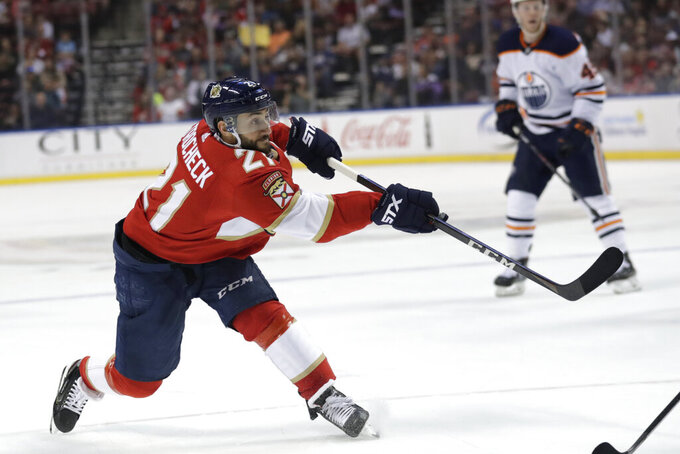 FILE - In this Feb. 15, 2020, file photo, Florida Panthers center Vincent Trocheck (21) shoots on the goal during the first period of an NHL hockey game against the Edmonton Oilers, in Sunrise, Fla. The Panthers traded Trocheck to the Carolina Hurricanes for Erik Haula, Lucas Wallmark and prospects Chase Priskie and Eetu Luostarinen, Monday, Feb. 24, 2020. (AP Photo/Lynne Sladky, File)