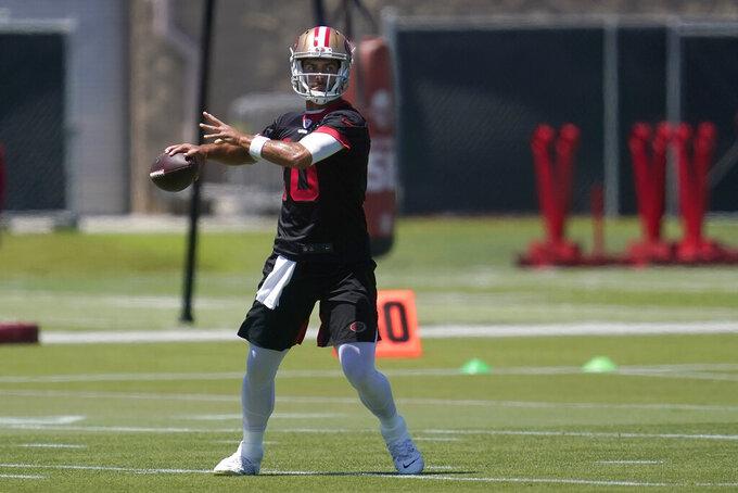 San Francisco 49ers quarterback Jimmy Garoppolo throws a pass at the team's NFL football training facility in Santa Clara, Calif., Tuesday, May 25, 2021. (AP Photo/Jeff Chiu)
