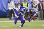 Minnesota Vikings defensive back Kris Boyd (38) and defensive back Anthony Harris (41) break up a pass intended for New York Giants tight end Evan Engram (88) during the fourth quarter of an NFL football game, Sunday, Oct. 6, 2019, in East Rutherford, N.J. (AP Photo/Bill Kostroun)